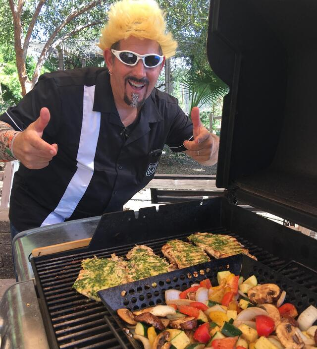 PERRY HEATS UP THE GRILL AS GUY FIERI!